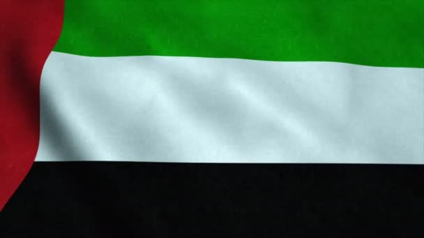 Realistic Ultra-HD flag of the United Arab Emirates waving in the wind. Seamless loop with highly detailed fabric texture