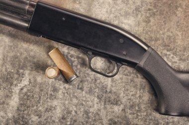 Weapon. Shotgun concept. Black shotgun and ammunition.