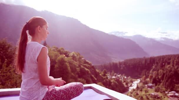 Beautiful Young Woman Doing Yoga Meditation Lotus Outdoors Sitting Asana Mat Roof House High Mountains, Sun. Toning, Lavender. Sun Rays, Morning, Summer, Manali, India, Himalayas