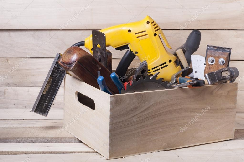 Construction tools on wooden table with sawdust. Joiner carpenter ...