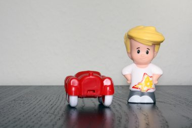 Toy car and boy figure