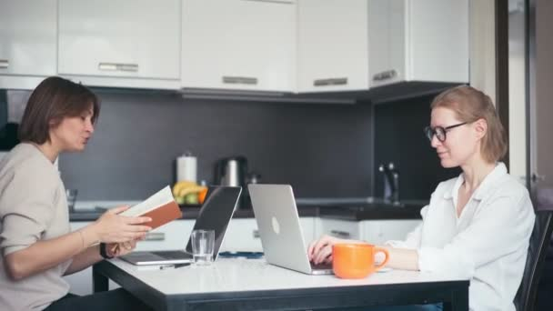 Two young women freelancers remote employee working from home