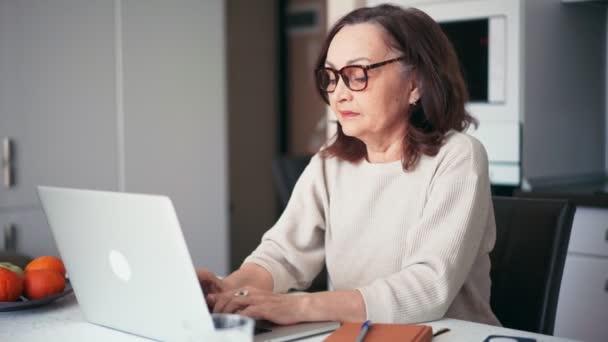 Overworked tired older lady having eyesight problem after computer work.