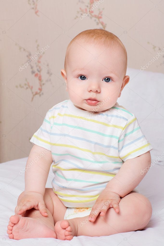 Child,baby happiness concept. Cute baby boy sits quietly on the bed. — Фото автора lacheev