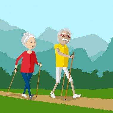 Nordic walking - active pensioners outdoor.