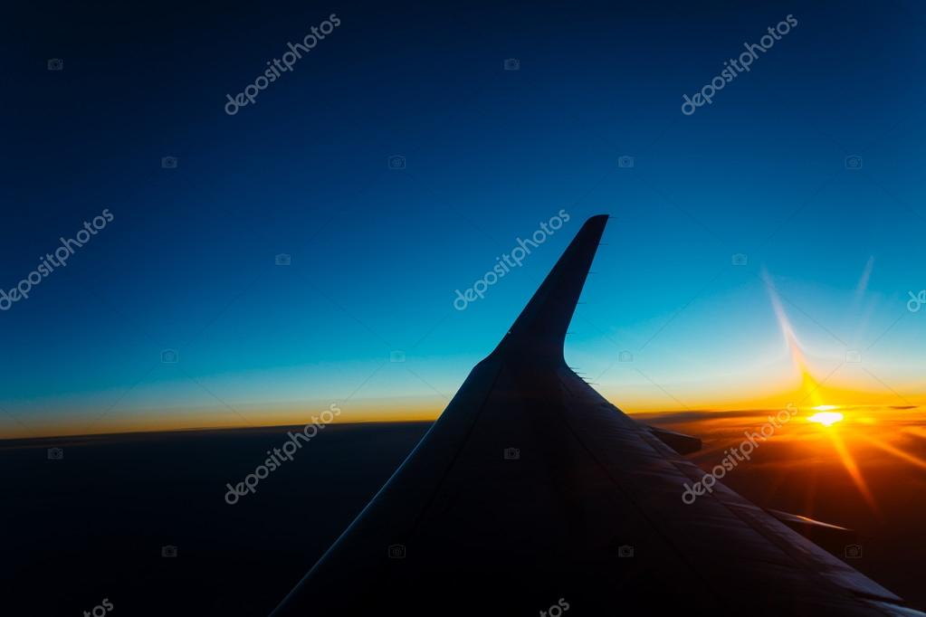 sunset view from the window of an airplane