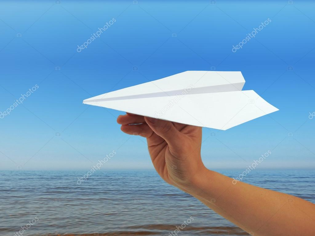 Paper plane in woman hand