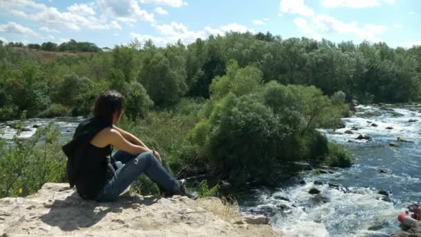 Gril looking on extreme rafting at turbulent rough river