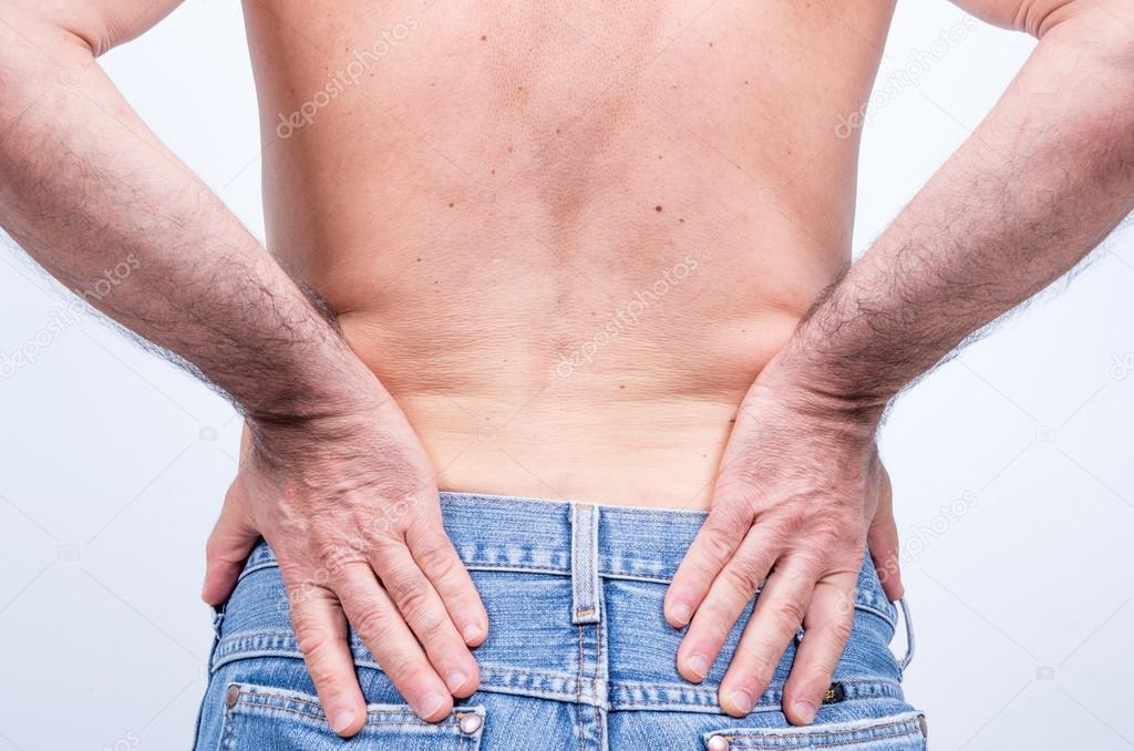 Middle aged Man with Severe Pain in the Lumbar Region pushes them to ...