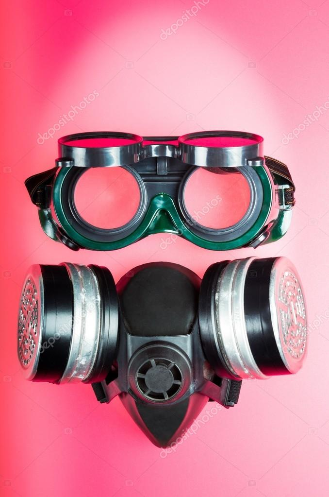 Goggles and a mask with filters for toxic fumes and