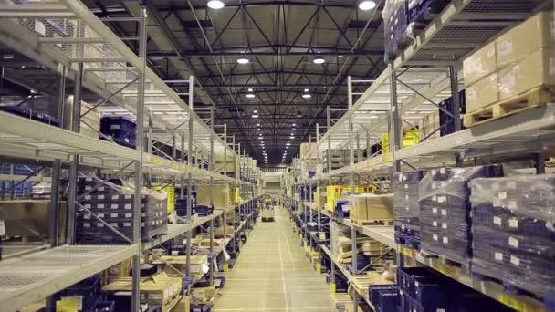 Shelves of cardboard boxes inside warehouse
