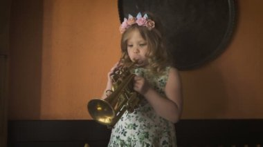 A Little Cute Girl Is Playing Saxophone In A Cozy Cafe Stock Footage
