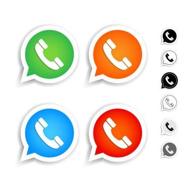 Phone handset in speech bubbles