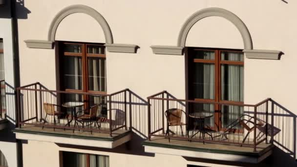 Two Outdoor Hotel Terrace , With Chairs and Tables