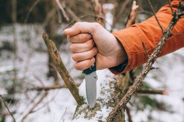 sharp pocketknife in a snowy woods