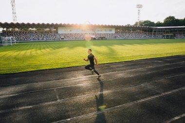 Runner on sport stadium