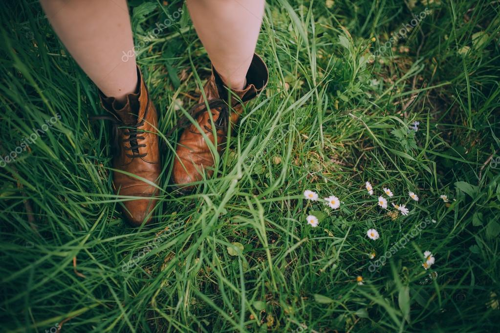 Young woman's legs in brown boots