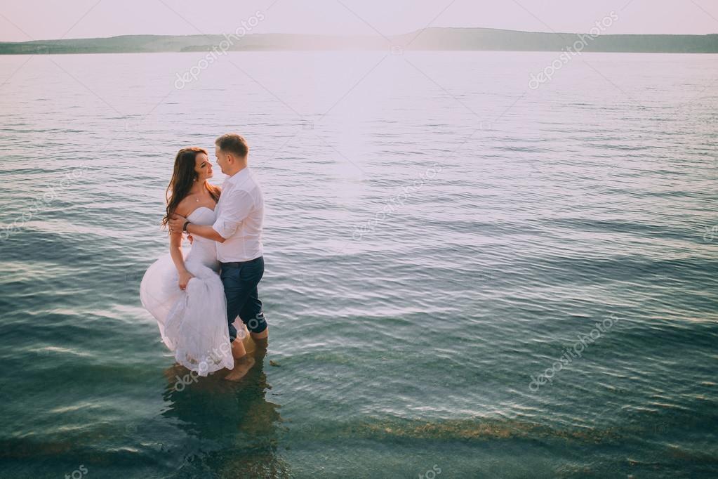 Romantic couple posingon the beach