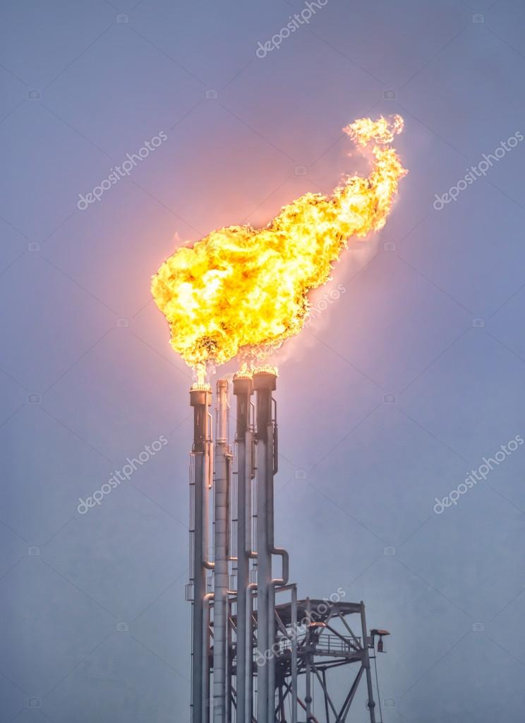 Flare stack, Burning oil gas flare in a large oil refinery, Abstract