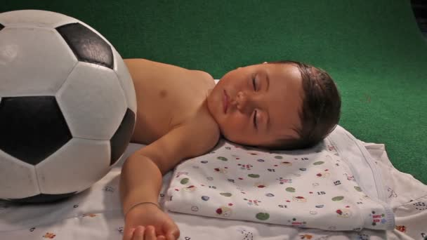 sleeping child with soccer