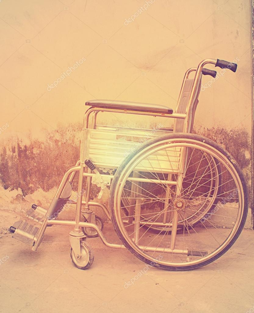 Vintage,Old Wheelchairs with wall background — Stock Photo © art ...