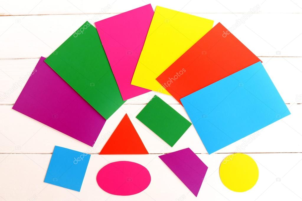 Multicolored cardboard geometric shapes. Kids education concept ...