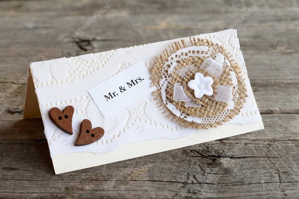 Vintage wedding invitation on old wooden table. Handmade wedding ...