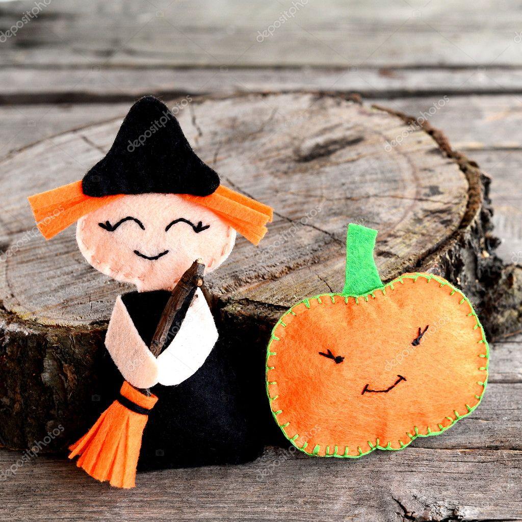 Halloween Felt Witch And Pumpkin Head Near The Stump Wooden