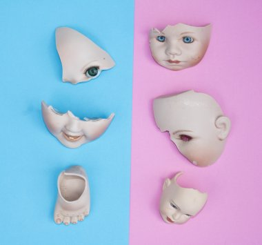 Baby Doll Head, Arms, Face Parts on Blue and Pink Background