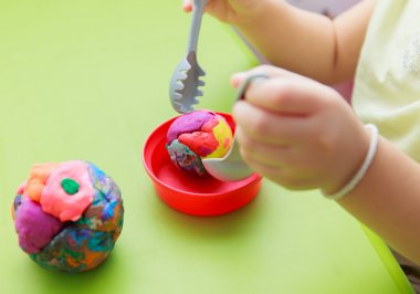 Childs hands Play Doh