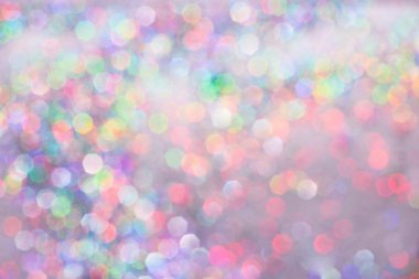 Purple and pink pastel abstract glitter background. Lights defocused and bokeh.