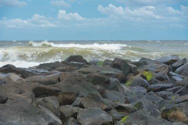 Stormy Seas by a Jetty