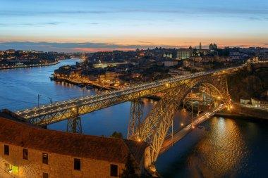 Dom Luis I Bridge in Porto on sunset background