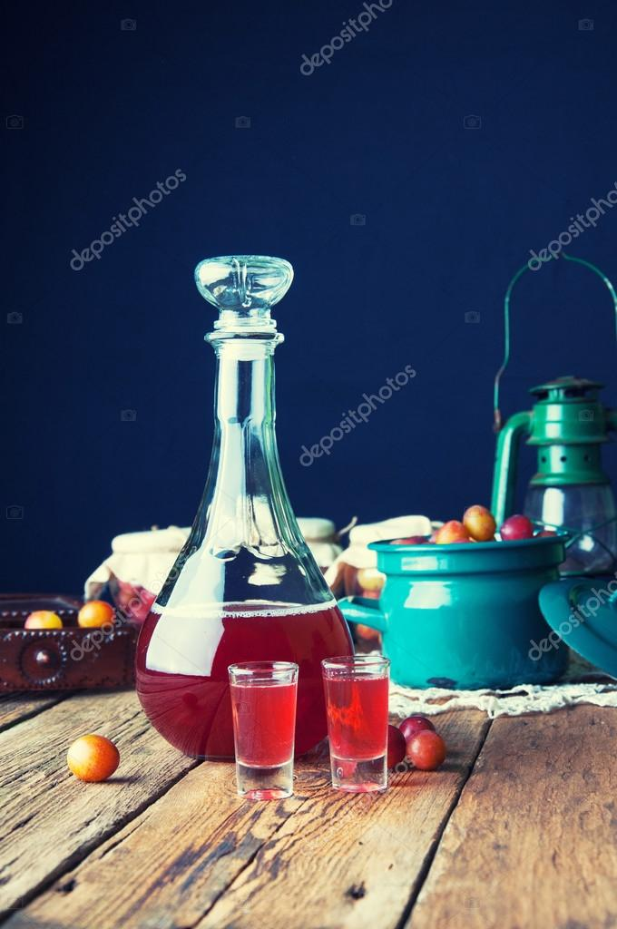 Healthy plum tincture in old kitchen — Stock Photo © monika