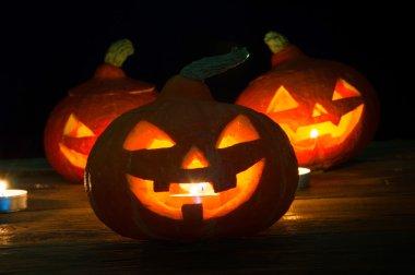 Scary halloween pumpkins on dark background
