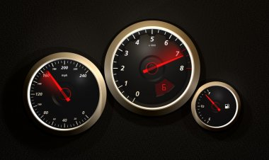 Car speedometer and rev counter.