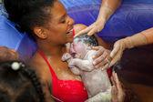 Fényképek Boldog anya és újszülött