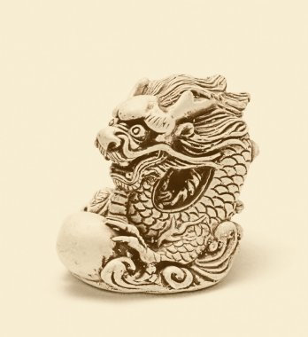 Netsuke of east dragon, which guarding the egg. Isolated