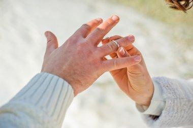 Groom wears bride a wedding ring
