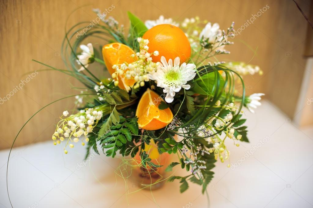 Flower arrangement of chrysanthemums and oranges
