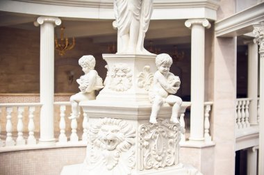 Plaster statues of seated boys