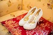 Wedding shoes cream color on the chair