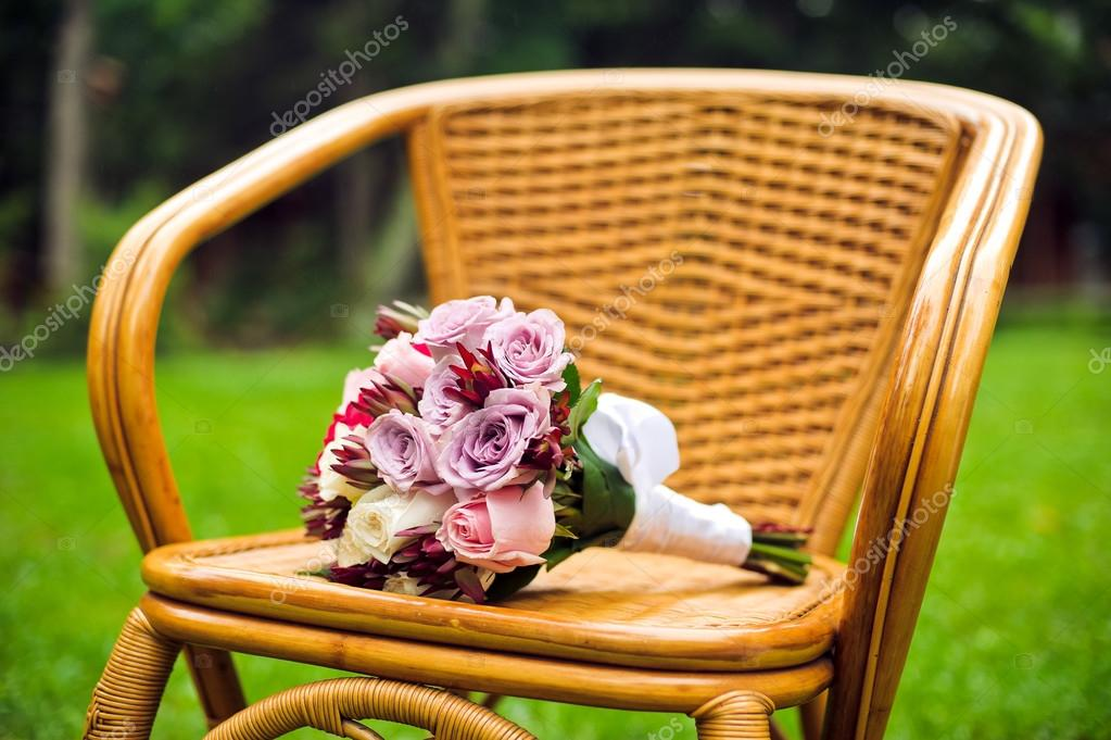 Purple bridal bouquet on a chair