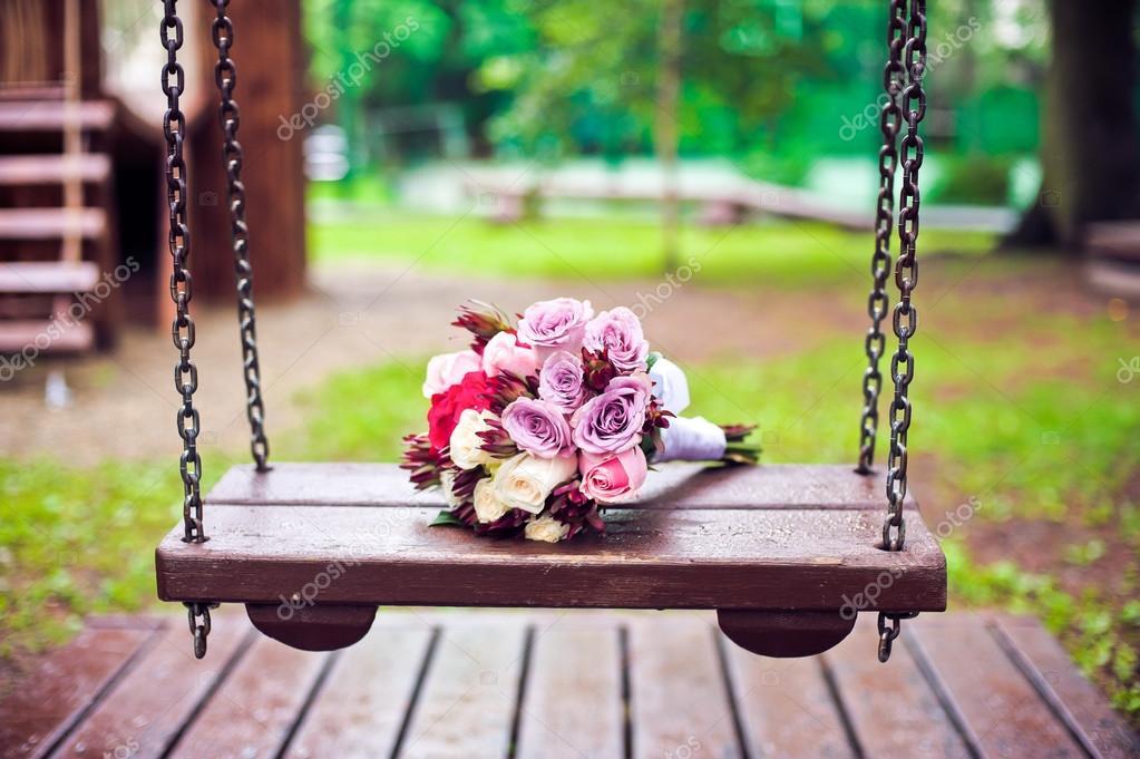 Violet bouquet bride on a swing