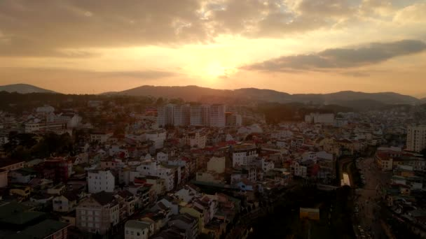Aerial shot. Sunset in the city of Dalat in the mountain part of a southern Vietnam. Travel to Vietnam concept