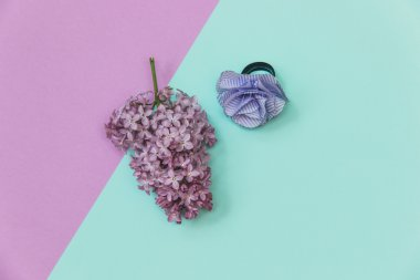 Lilac flowers and artificial flower