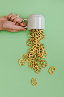 cup with pouring pretzels
