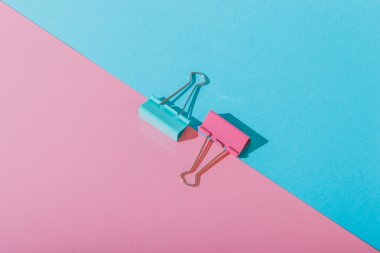 Pink and blue paper clips