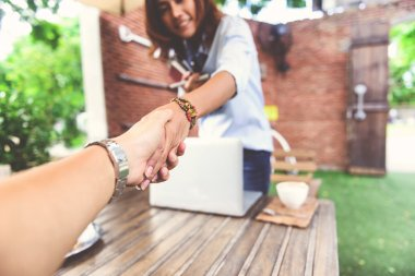 Photos of Asian women who are shaking hand