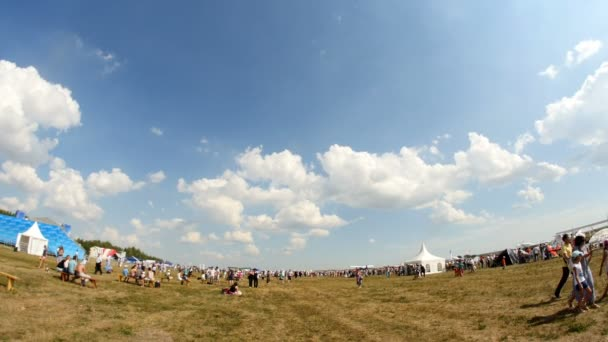 12 August 2016, Kazan, Russia - Kurkachi air show: the crowd at the festival walking on the airfield, ultra wide angle